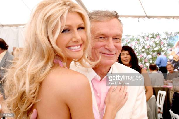 Playmate Of The Year Brande Roderick poses with Hugh Hefner at the Playmate Of The Year Party April 26 2001 in Los Angeles CA