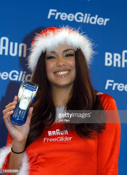 Playmate of The Year Christina Santiago during Playboy Playmates and Braun Freeglider Host PreHoliday Personal Shave Session In Times Square at Times...