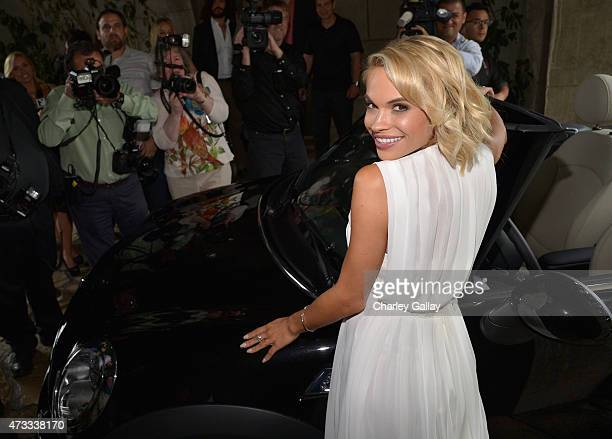 Playmate of the Year Dani Mathers poses with her new 2015 MINI Cooper S Convertible in Midnight Black at Playboy's 2015 Playmate of the Year Ceremony...