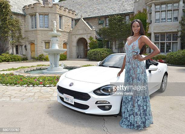 Playmate of the Year Eugena Washington poses with her new AllNew 2017 Fiat 124 Spider at Playboy's 2016 Playmate of the Year Announcement at the...