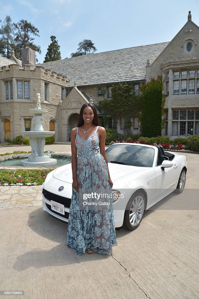 Playmate of the Year Eugena Washington poses with her new All-New 2017 Fiat 124 Spider at Playboy's 2016 Playmate of the Year Announcement at the Playboy Mansion on May 11, 2016 in Los Angeles, California.