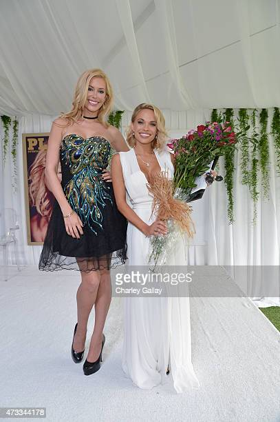 Playmate of the Year Kennedy Summers and 2015 Playmate of the Year Dani Mathers pose onstage during Playboy's 2015 Playmate of the Year Ceremony at...