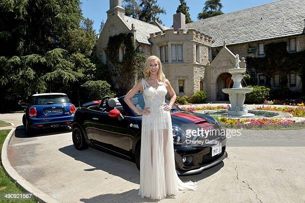 Playmate Of The Year Kennedy Summers poses with her MINI John Cooper Works Roadster during Playboy's 2014 Playmate Of The Year Announcement and...