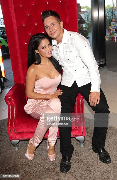 Playmate of the year, Mia Gray and her boyfriend Oliver Kobs attend the Citroen C4 Cactus Munich preview on July 31, 2014 in Munich, Germany.