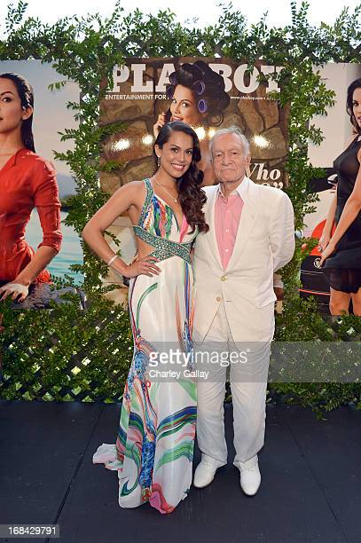 Playmate Of The Year Raquel Pomplun and Hugh Hefner pose onstage during Playboy's 2013 Playmate Of The Year luncheon at The Playboy Mansion on May 9...