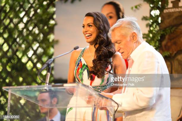 Playmate of the Year Raquel Pomplun and Hugh Hefner speak onstage during Playboy's 2013 Playmate of the Year luncheon at The Playboy Mansion on May 9...
