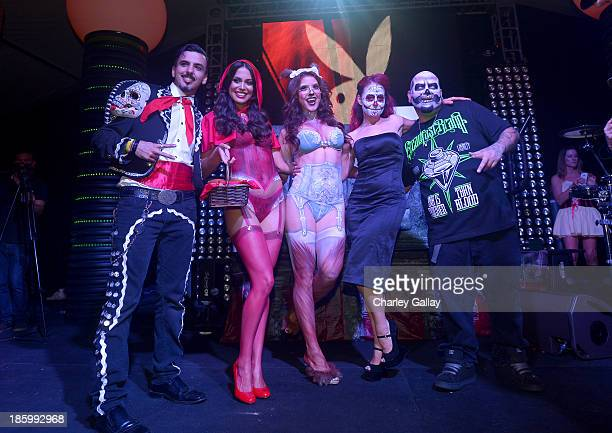 Playmate of the Year Raquel Pomplun , Playmate Amanda Cerny and the cast of Syfy's Naked Vegas pose onstage at Playboy Mansion's annual Halloween...