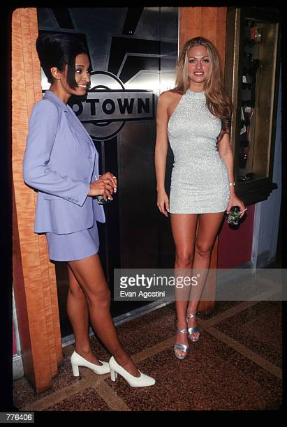 Playmate of the Year Stacy Sanches and June 1996 Playmate of the Month Karin Taylor stand at Operation Playmate A Salute to America's Veterans at the...