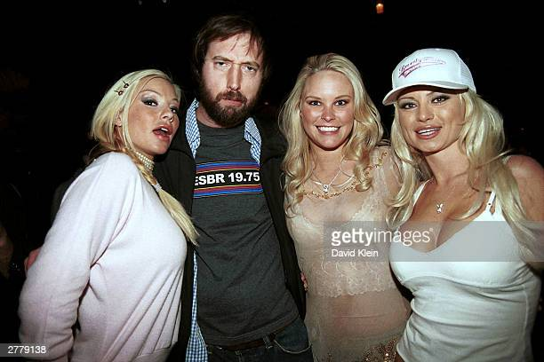 Playmate Zoe Late Night Host Tom Green Ms October 2003 Audra Lynn and Playmate Isabella pose at Bliss November 28 2003 in Beverly Hills CA