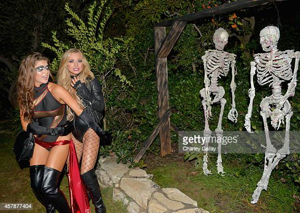 Playmates Amanda Cerny and Nikki Leigh attend Playboy Mansion's Annual Halloween Bash at The Playboy Mansion on October 25, 2014 in Los Angeles,...