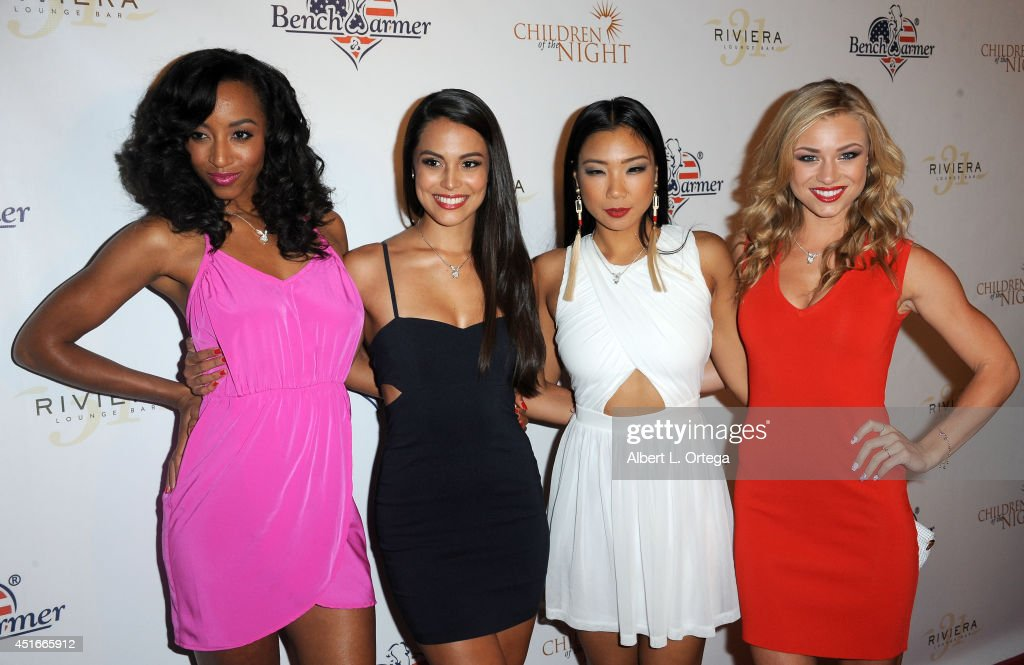 Playmates dancers Neferteri Shepherd, Raquel Pomplun, Hiromi Oshima and Nikki Leigh arrive for BenchWarmer's Annual Stars & Stripes Celebration held at Riviera 31 on July 1, 2014 in Beverly Hills, California.