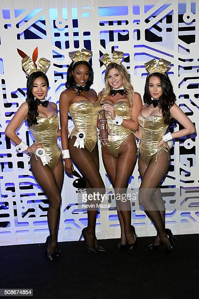 Playmates Hiromi Oshima Eugena Washington Carly Lauren and Ashley Doris wear Bunny costumes inspired by the gold detailing on EFFEN Vodka's limited...