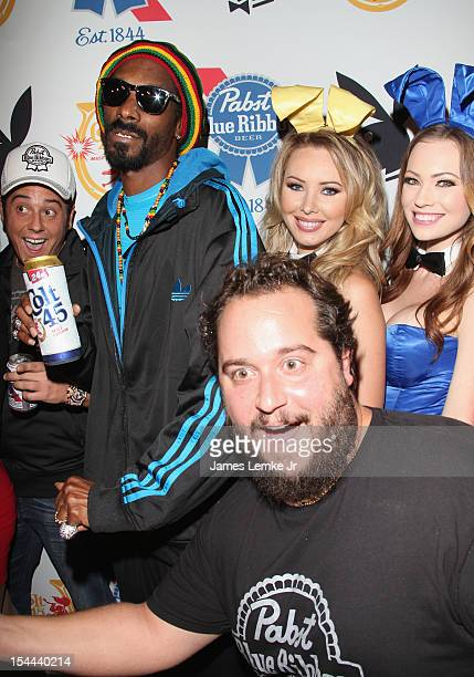 Playmates Kimberly Phillips and Tiffany Toth attend the Snoop Dogg Presents Colt 45 'Works Every Time' mansion party with Evan and Daren Metropoulos...