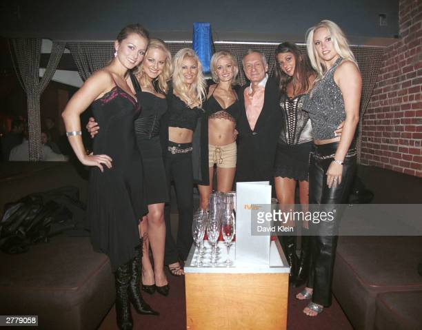 Playmates Marketa Janska, Divini Rae, Christa Campbell, Holly Madison, Publisher Hugh Hefner, Amber Campisi and Audra Lynn pose at the Ivar Theater...