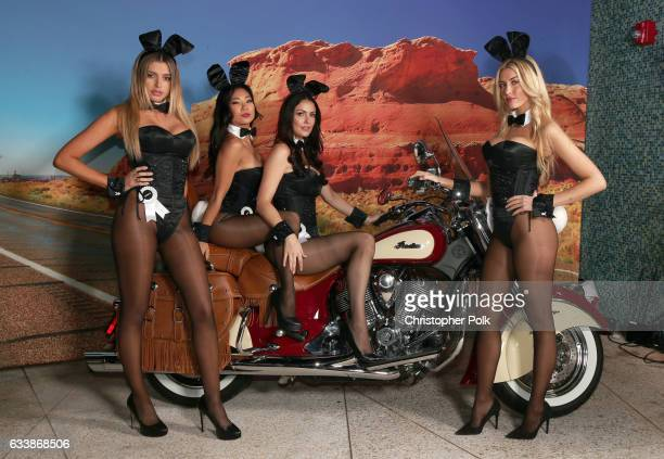 Playmates Monica Sims Hiromi Oshima Summer Altice and Heather Rae Young poses on the Indian Motorcycle during the Playboy party with TAO at Spire...