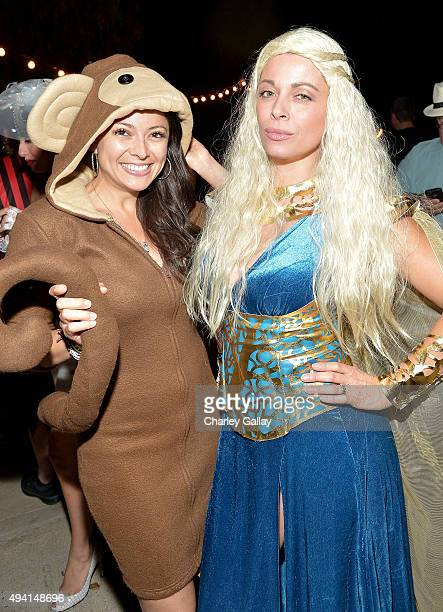 Playmates Pilar Lastra and Angel Boris attend the annual Halloween Party hosted by Playboy and Hugh Hefner at the Playboy Mansion on October 24 2015...