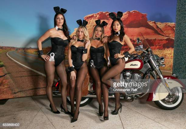 Playmates Summer Altice Heather Rae Young Monica Sims and Hiromi Oshima poses on the Indian Motorcycle during the Playboy party with TAO at Spire...