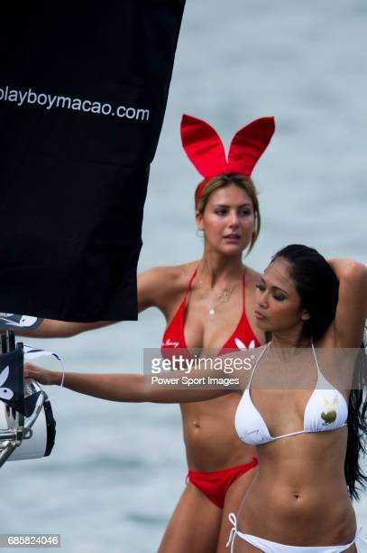 Playmates wave and dance on the Playboy boat during the Hong Kong's Dragon Boat Festival also known as Tuen Ng Festival in Stanley beach Hong Kong on...