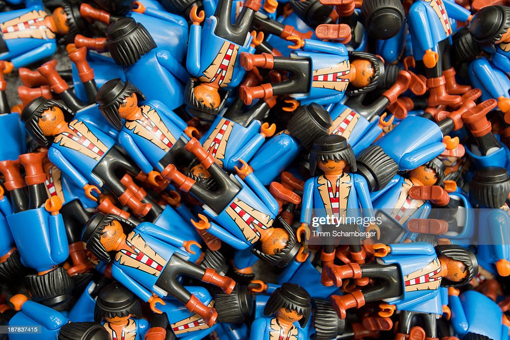Playmobil toy figures pictured at the playmobil toy factory in Dietenhofen on November 12, 2013 in Dietenhofen, Germany. The first Playmobil figures were developed by cabinetmaker Hans Beck in the early 1970's and the first Playmobil lineup launched in 1974 by toy manufacturer geobra Brandstaetter. Playmobil, known for its plastic toy action sets of knights, pirates, farmers, firemen, police and Native Americans, will mark its 40th anniversary in 2014.