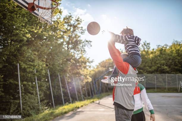 playng basketball with my family - basketball hoop stock pictures, royalty-free photos & images