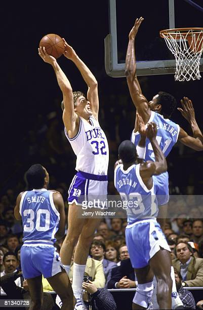 ACC playoffs Duke Mark Alarie of the Duke Blue Devils goes up for a shot against Sam Perkins of the North Carolina Tar Heels on March 10 1984 in...