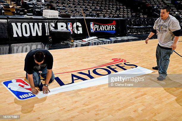 'NBA Playoffs' logos are applied to the court before the Los Angeles Lakers play the San Antonio Spurs in Game Two of the Western Conference...