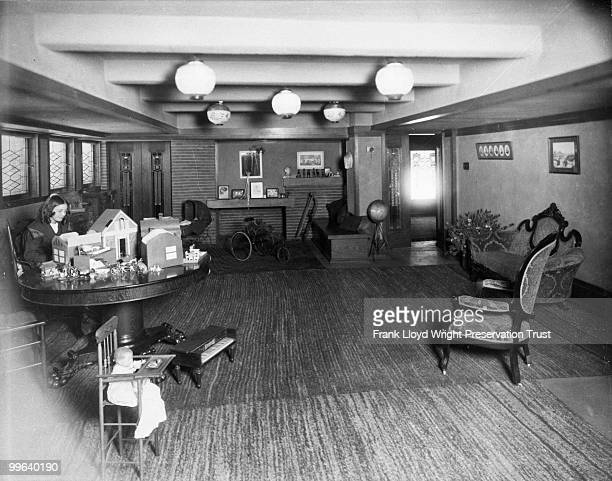 Playroom looking west with Jeannette Wilber at table Nonoriginal furniture and light fixtures in room Chicago Illinois 1916