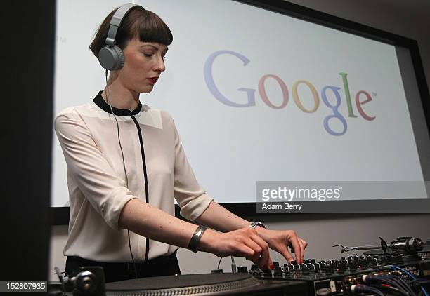 DJ plays music on September 26 2012 at the official opening party of the Google offices in Berlin Germany Although the American company holds 95% of...