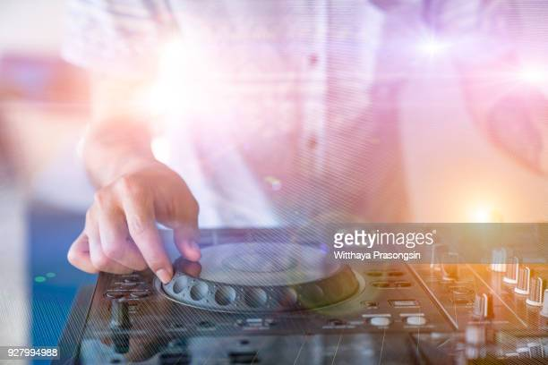 DJ plays on the best, famous CD players at nightclub during party. EDM, party concept.