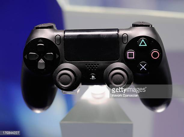 Playstation 4 and its controller is on display at the Sony Playstation E3 2013 booth at the Los Angeles Convention Center on June 11 2013 in Los...