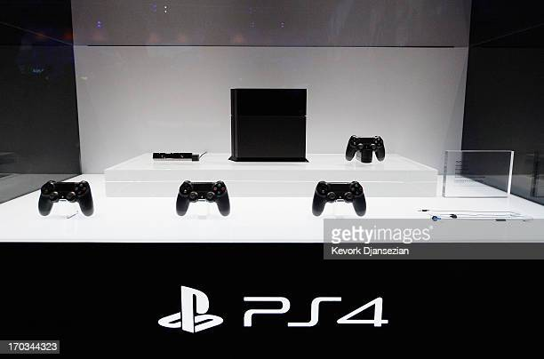 Playstation 4 and its controllers on display at the Sony Playstation E3 2013 booth at the Los Angeles Convention Center on June 11 2013 in Los...