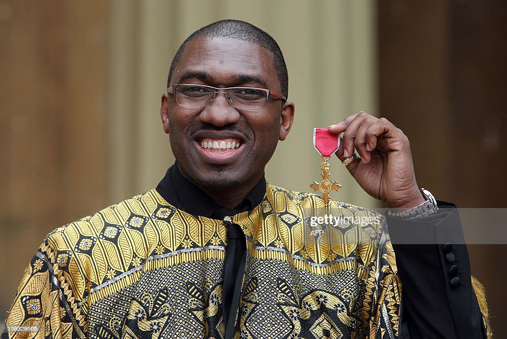 Playwright and actor Kwame Kwei-Armah poses with his Officer of the British Empire (OBE) medal following an Investiture ceremony at Buckingham Palace in central London on December 13, 2012.