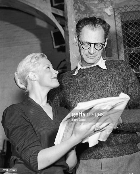 US playwright Arthur Miller discusses the script of his new play 'A View From The Bridge' with actress Mary Ure at the Comedy Theatre19th September...