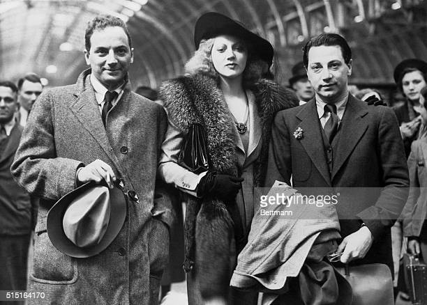 Playwright Clifford Odets with Luther Adler, actor, and his sister, Stella, in London.