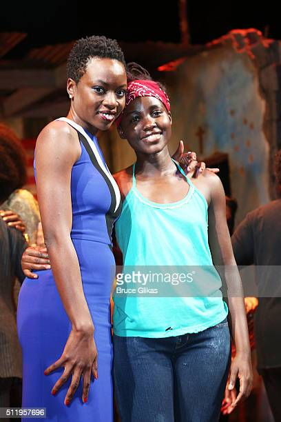 """Playwright Danai Gurira and Lupita Nyong'o pose onstage after the first preview of """"Eclipsed"""" on Broadway at The Golden Theatre on February 23, 2016..."""