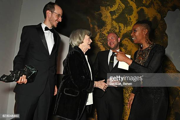 Playwright Jack Thorne, presenter Maggie Smith, director John Tiffany and actress Noma Dumezweni, accepting the Best Play award with Hiscox for...