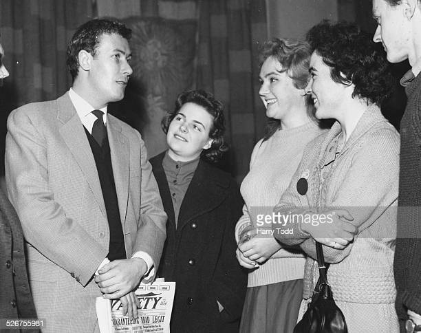 Playwright John Osborne chatting with a group of students following his lecture on the 'American Theatre' at the University of London January 2nd 1959