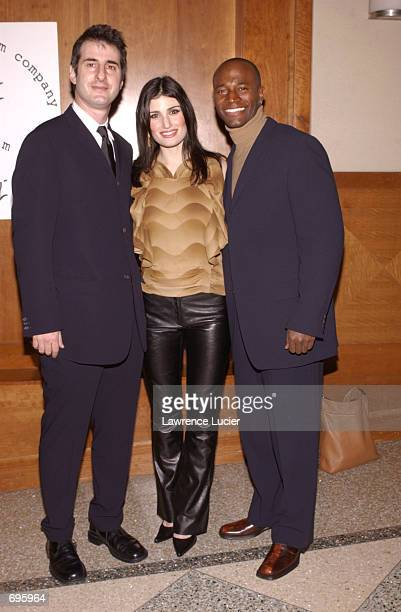 Playwright Jon Robin Baitz actress Idina Menzel and model Taye Diggs arrive at the New York Stage and Film Benefit Gala February 10 2002 in New York...