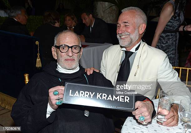 Playwright Larry Kramer and David Webster pose for a picture on June 9 2013 in New York City