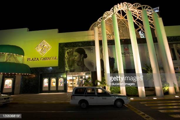 Plaza Caracol shopping mall illuminated Cancun Quintana Roo Mexico.