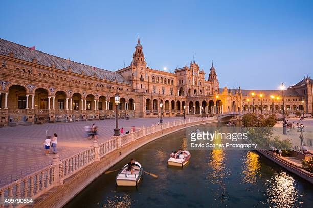 plaza de españa at dusk, seville, spain - seville stock pictures, royalty-free photos & images