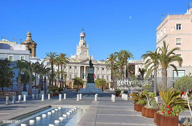 Plaza de San Juan de Dios, Cadiz with the old Town Hall at the far end. It is a very large plaza built on reclaimed land many centuries ago.