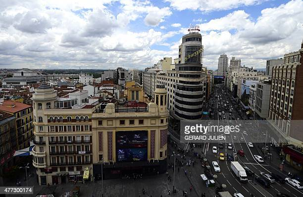 Plaza del Callao and the Capitol Art Deco building are seen off Gran Via in the centre of Madrid on June 15 2015 AFP PHOTO/ GERARD JULIEN