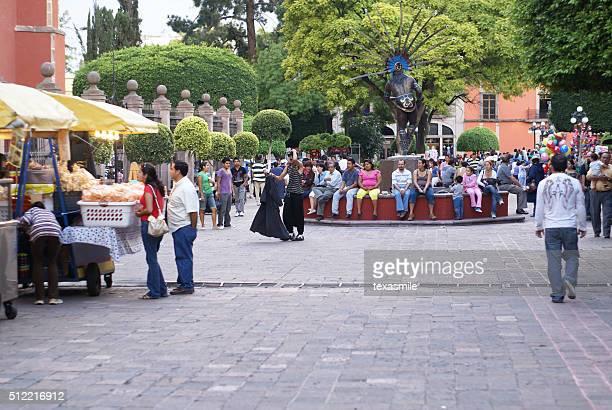 Plaza in Santiago de Queretaro with crowd of people, Mexico