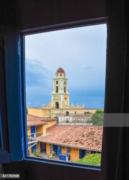 Plaza Mayor and St. Francis church seen through a church window in Trinidad, Cuba, a UNESCO Heritage site