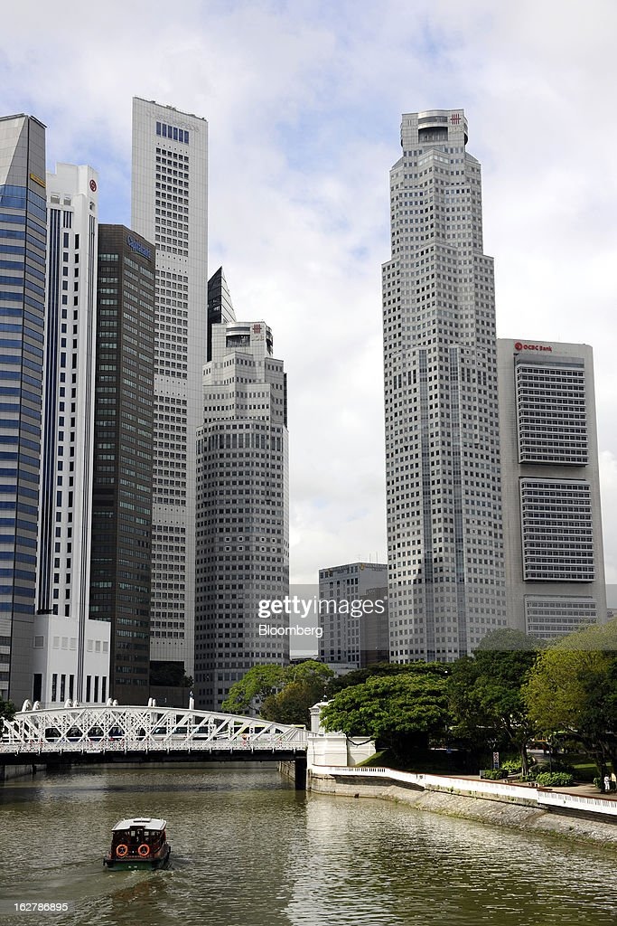 UOB Plaza One, second right, which houses the headquarters of United Overseas Bank Ltd. (UOB), stands among other buildings in the central business district in Singapore, on Wednesday, Feb. 27, 2013. UOB is scheduled to announce full year results today. Photographer: Munshi Ahmed/Bloomberg via Getty Images