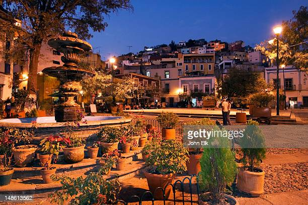 plazuela de san fernando with fountain and potted plants. - guanajuato stock pictures, royalty-free photos & images
