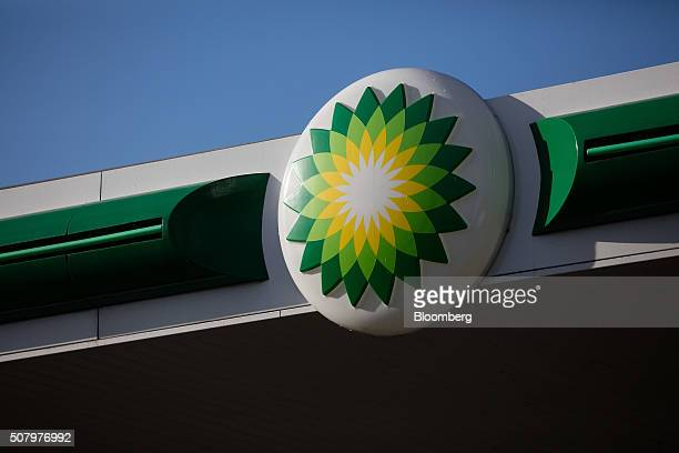 Plc logo sits on a forecourt canopy at gas station operated by BP Plc in London UK on Tuesday Feb 2 2016 BP Plc reported a 91 percent decline in...