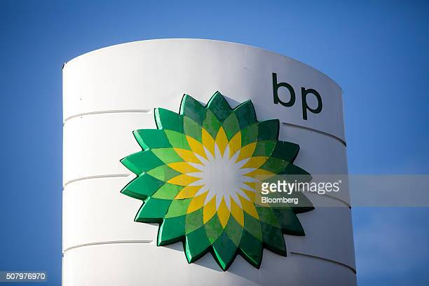 Plc logo sits on a totem sign outside a gas station operated by BP Plc in London UK on Tuesday Feb 2 2016 BP Plc reported a 91 percent decline in...