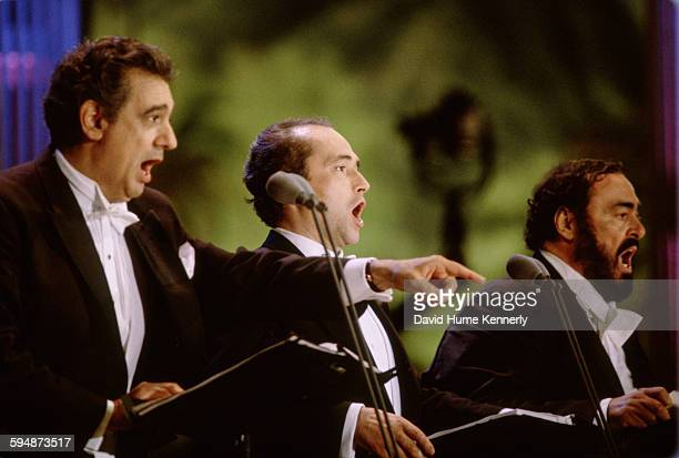 Plácido Domingo José Carreras and Luciano Pavarotti perform at The Three Tenors concert at Dodger Stadium July 16 1994 in Los Angeles The concert is...
